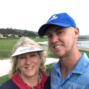 Carla with her son on the golf course