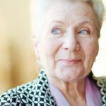 A beautiful older woman with blue eyes looking to the side